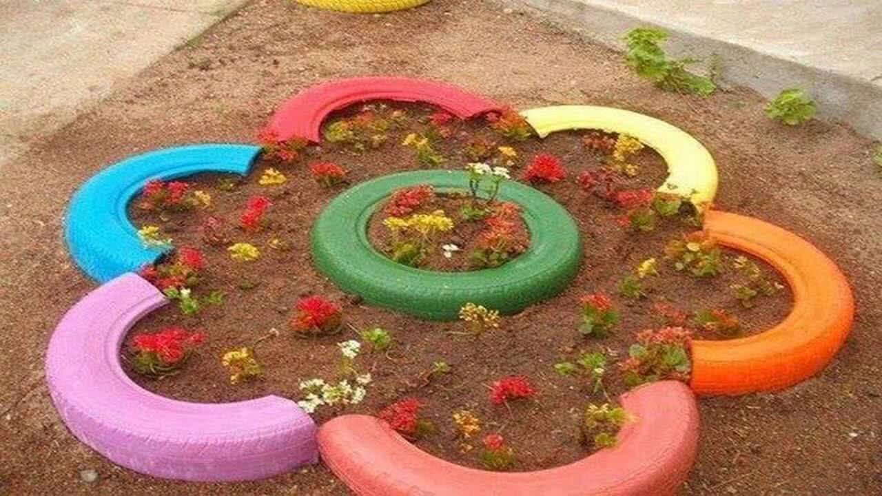 Tyre gardening creative ideas for old tyres for Car tire flower planter