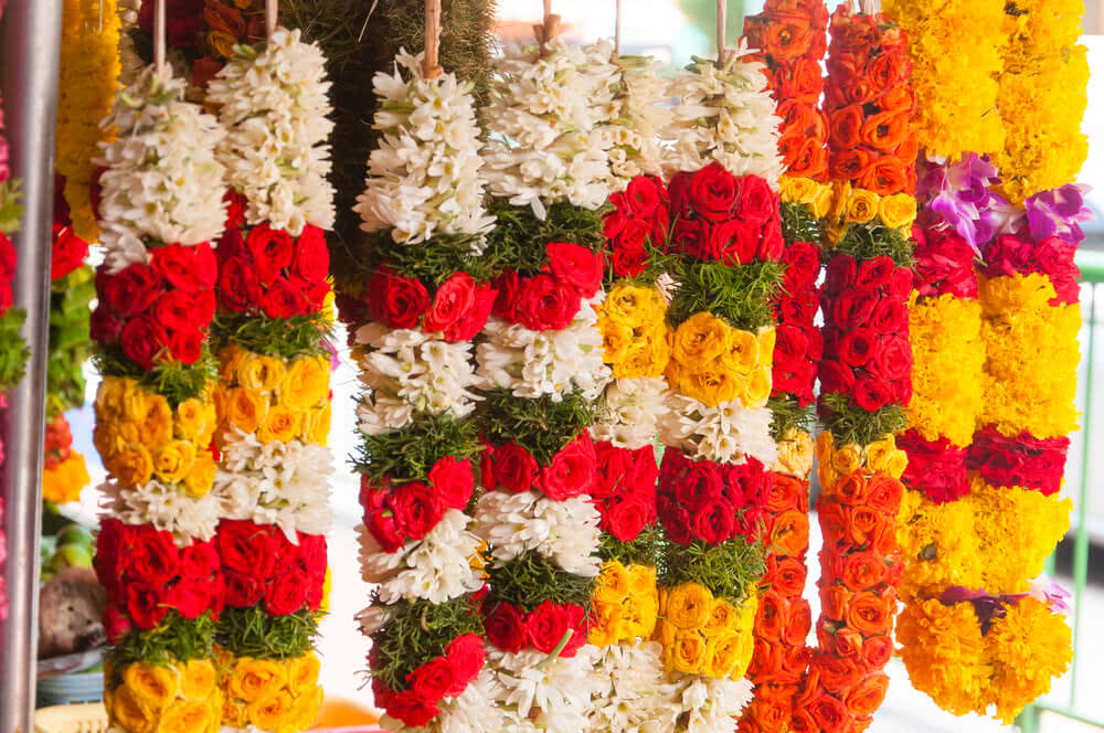 colorful fresh flower garlands in the market