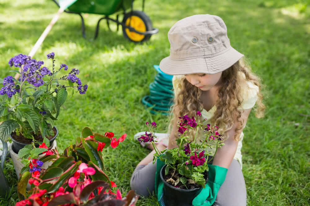 little girl busy in gardening work