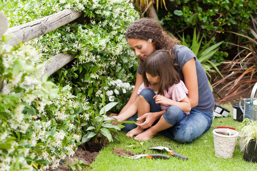 mother teaching gardening to her child in diwali vacations