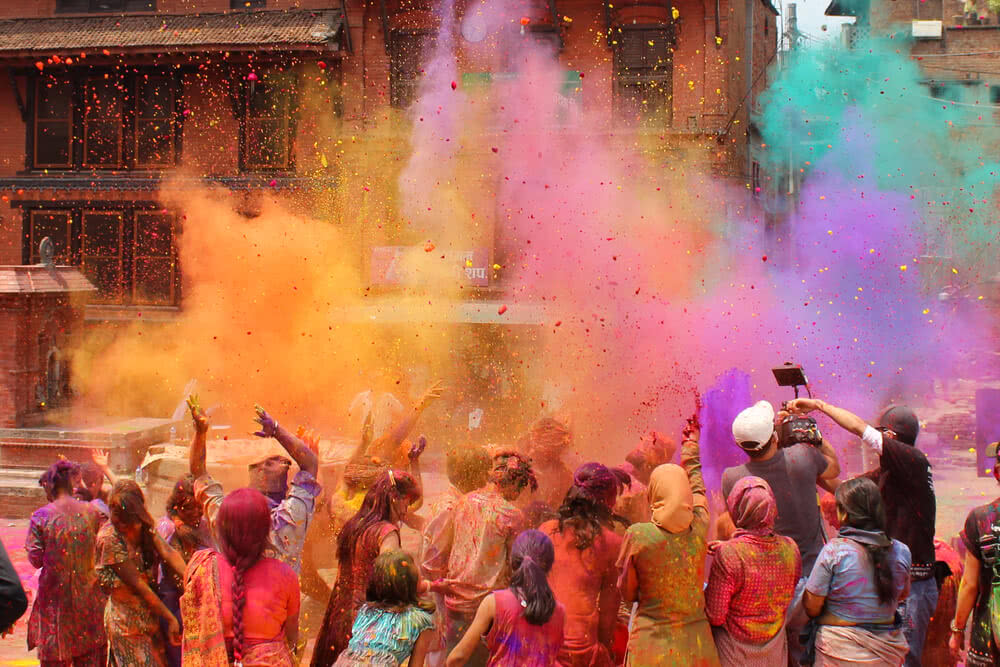People wore dark clothes for celebrating holi