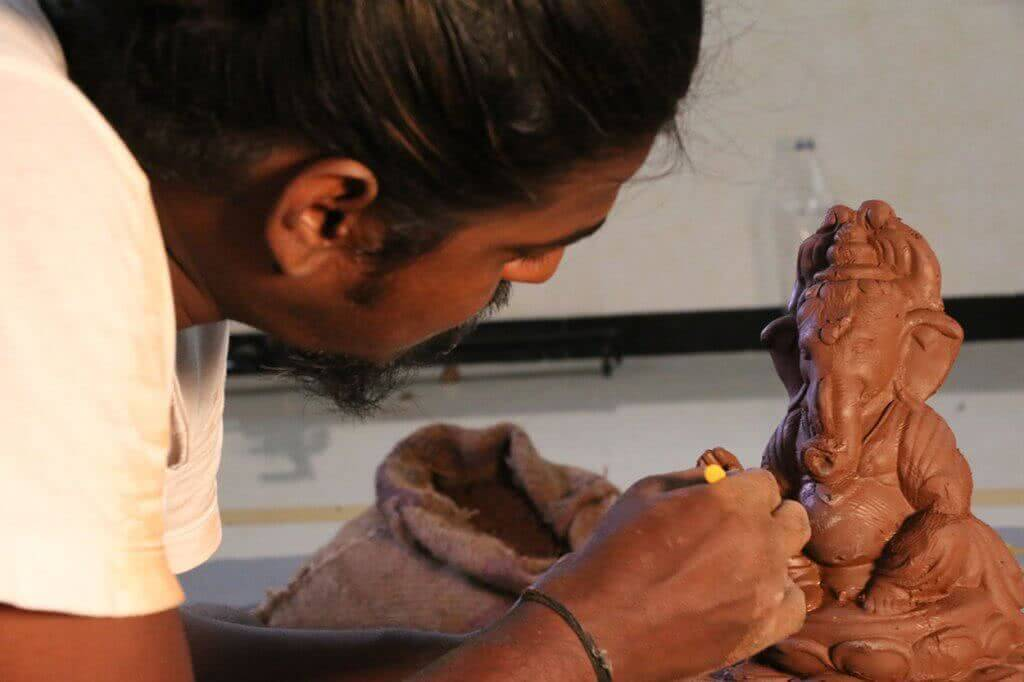 Making Ganesha idol with soil, seeds and organic fertiliser